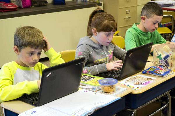 Shabonee School third-graders, from left to right, Alex Sherrow, Annie Geister and Noah Shulman, work on their writing on a netbook in Sandy Olson's class. Northbrook School District 27 will soon start implementing its new math curriculum.