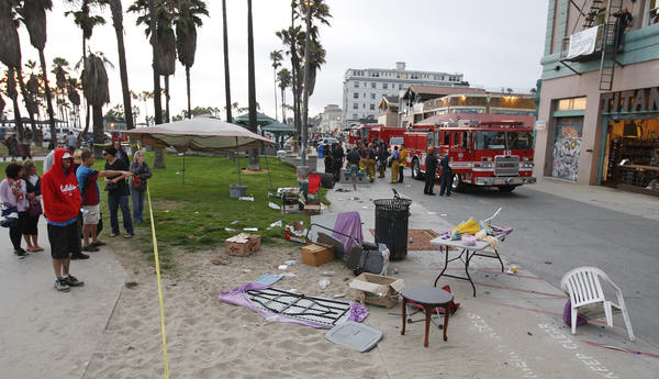 Debris litters the scene after a person drove a car onto the crowded Venice boardwalk and struck several people Saturday, killing one and injuring 16.