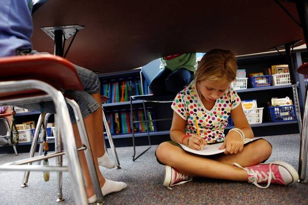 Erin Nukk, 8, writes in her notebook under one of the tables during Independent Writing Time in Laura Zerull's third grade class at Glenview's Pleasant Ridge Elementary School Tuesday, Sept. 7, 2010. Glenview School District 34 is about to officially adopt its new curriculum, based on the Common Core State Standards.