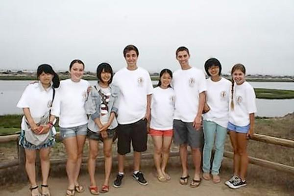 Students from Huntington Beach and Anjo, Japan, take a walking tour of the Bolsa Chica Wetlands.