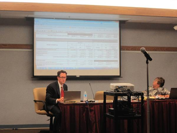 New bids for summer projects, and previous ones, are posted on screen at a recent meeting of HInsdale Township High School District 86.