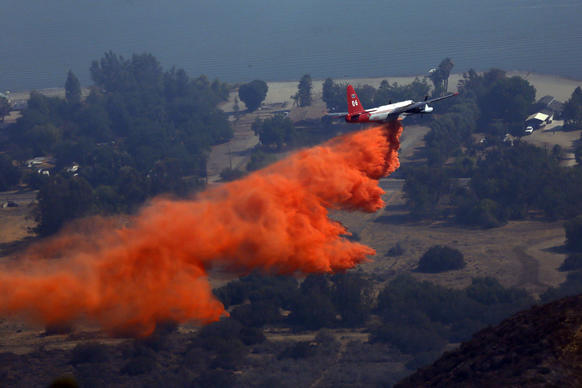 The air assault continued Tuesday morning to contain the 1,500-acre Falls fire near Lake Elsinore.