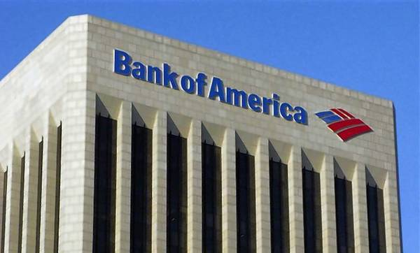 The logo of the Bank of America is pictured atop the Bank of America building in downtown Los Angeles.