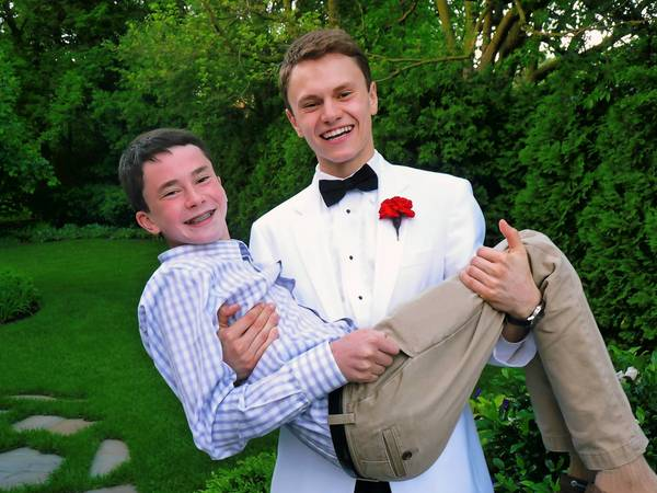 Jordan Klein holds his brother, Josh, 14, after Jordan gave the New Trier High School Class of 2013 commencement speech at Welsh-Ryan Arena in Evanston.
