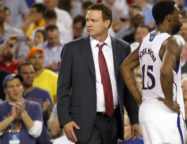 Kansas head coach Bill Self and Elijah Johnson (15) leave the court following an 87-85 loss in overtime against Michigan in the NCAA Tournament's Sweet 16 at Cowboys Stadium in Arlington, Texas on Friday, March 29, 2013. (Ron Jenkins/Fort Worth Star-Telegram/MCT) ORG XMIT: 1136871