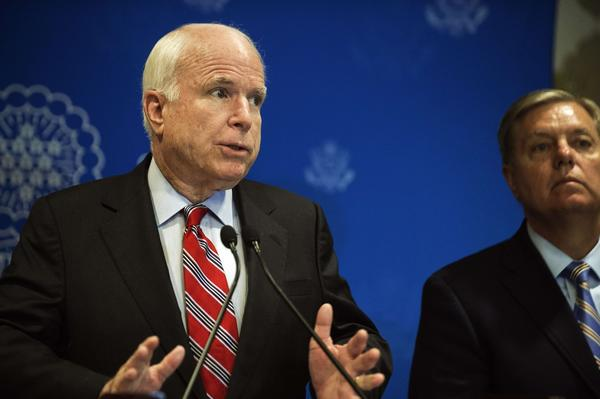 Republican Sens. John McCain of Arizona, left, and Lindsey Graham of South Carolina address a news conference in Cairo.
