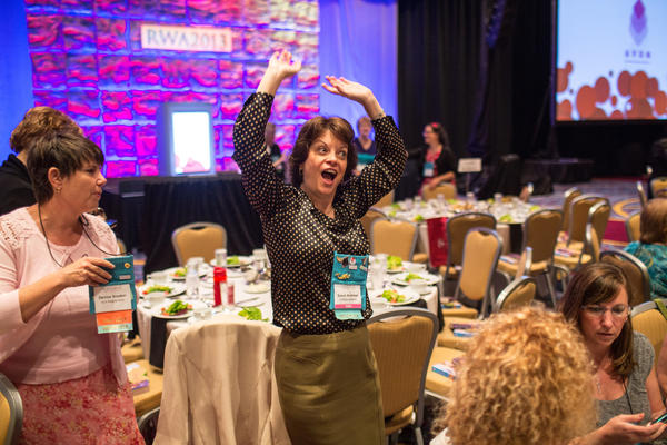 7/18/13 - Atlanta, Ga. - Susan Andrews dances to music as nearly the entire convention streams into the Cathy Maxwell keynote lunch talk. Several thousand attendees gathered at the Marriott Marquis in downtown Atlanta for the annual Romance Writers of America convention. (Raymond McCrea Jones/for the Chicago Tribune) ORG XMIT: B583067308Z.1 ...OUTSIDE TRIBUNE CO.- NO MAGS, NO SALES, NO INTERNET, NO TV, CHICAGO OUT, NO DIGITAL MANIPULATION...