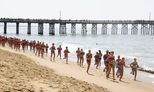 Newport Beach Junior Lifeguards run during the Monster Mile on Friday.