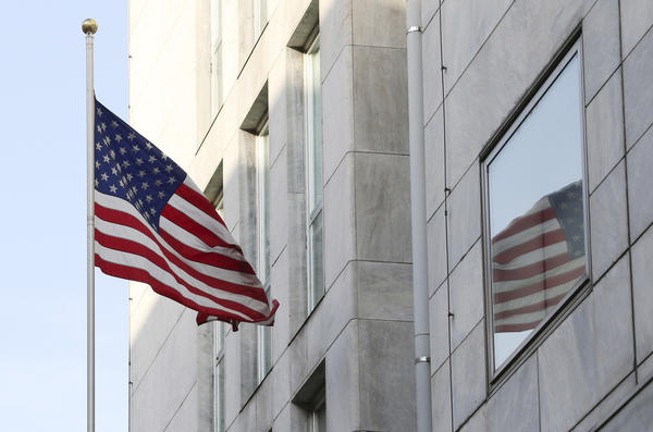 An American flag flies outside the U.S. Consulate in Milan, which was temporarily evacuated Tuesday after receiving a letter containing a bomb threat.