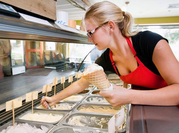 Tatum Hanisak, 17, of Tinicum Township, dishes up a cone at the oWowCow Creamery in Ottsville.