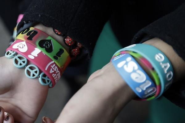 "In Pennsylvania, students display their ""boobie bracelets."""