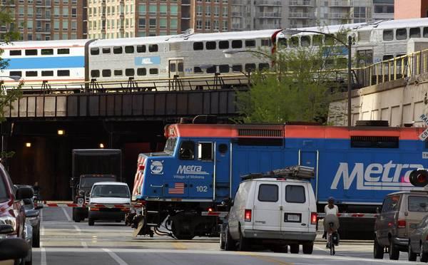 Metra trains near Kinzie and Clinton.