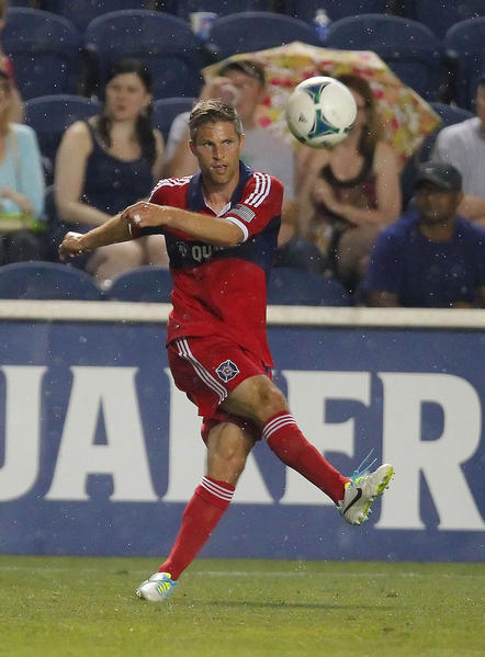 Fire midfielder Logan Pause kicks the ball during the second half against D.C. United at Toyota Park.