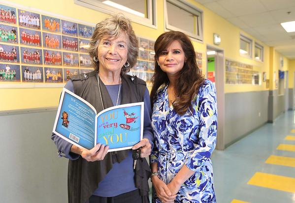 "Elsa Brizzi, left, stands with Laguna Beach Seniors program and volunteer coordinator Christine Brewer at the Boys & Girls Club. Brizzi holds her book ""You Are a Very Special You."""