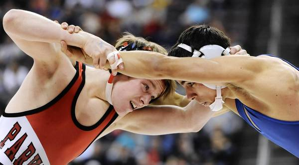 (Left) Parkland's Ethan Lizak defeats Norristown's Zack Fuentes with a score of 3-1 in the 113 pound weight class in the finals of the PIAA Class 3A Wrestling Championships held at the Giant Center in Hershey on Saturday March 9, 2013.
