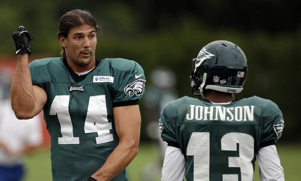 Philadelphia Eagles wide receivers Riley Cooper, left, and Damaris Johnson talk during a training camp session Tuesday.