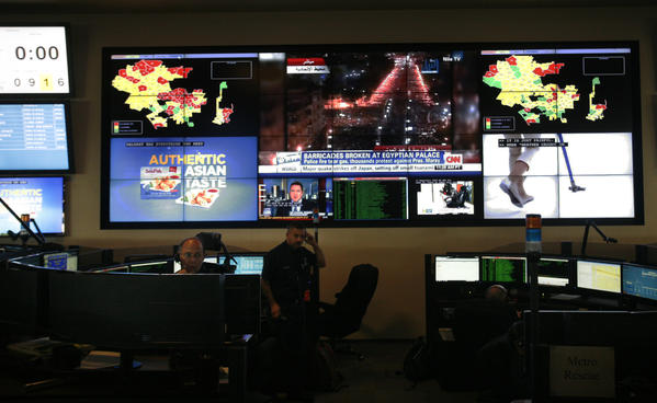 Electronic maps of the city and television station broadcasts play on the wall at the Los Angeles Fire Department Dispatch Center.