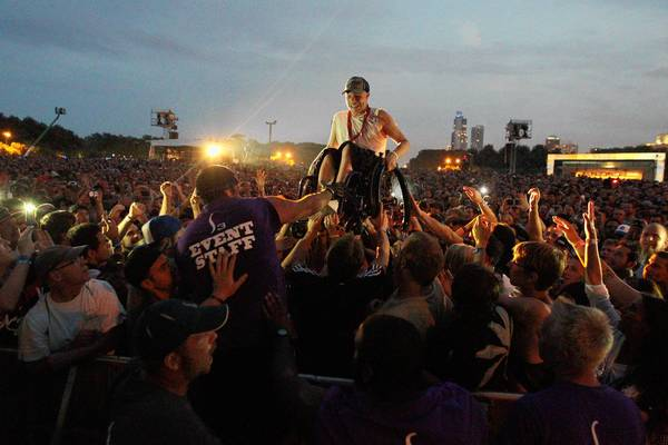 Rick Guardino is carried aloft in his wheelchair by the crowd toward the edge of the stage at the Nine Inch Nails set Friday at Lollapalooza in downtown Chicago.