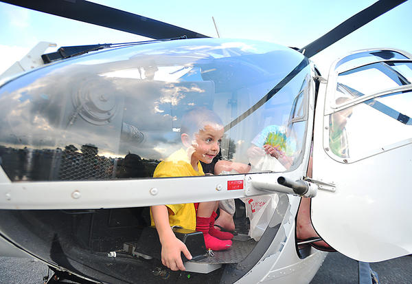 Hunter Burker, 4, of Hagerstown checks out the cockpit of the Air Methods helicopter Tuesday during National Night Out at Fairgrounds Park in Hagerstown.