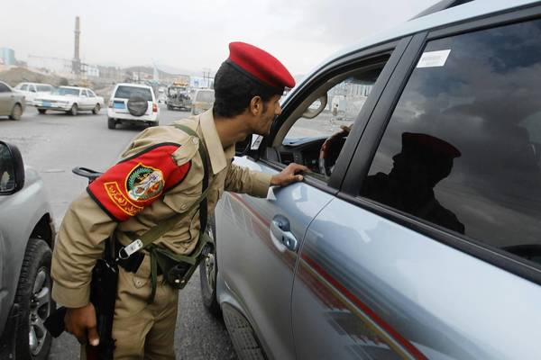 A military police trooper checks a car Tuesday in Sanaa, Yemen. The U.S. State Department has advised Americans to leave Yemen because of the threat of terrorism.