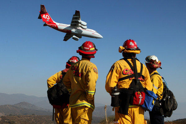 The air assault continued Tuesday against the Falls fire near Lake Elsinore.