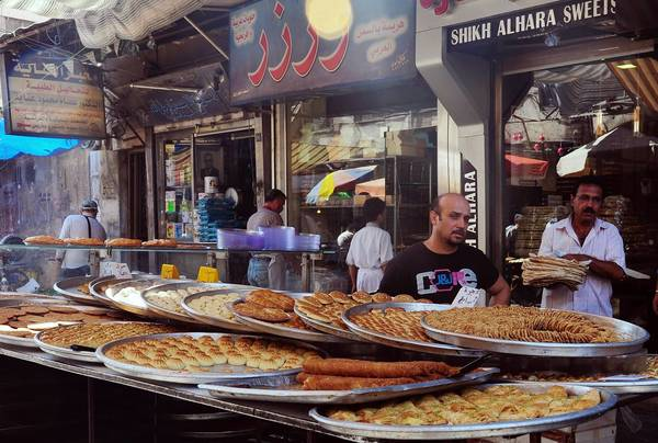 Pastries are offered for sale outside a shop in central Damascus. Though much of the news out of Syria focuses on the civil war between the government and rebels trying to oust President Bashar Assad, the nation is also fighting a battle to remain afloat economically.
