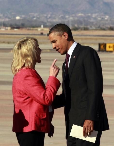 Arizona Gov. Jan Brewer has an intense conversation with President Obama in January 2012 after his plane landed in Mesa, Ariz. Their meeting this time, on the tarmac at Phoenix Sky Harbor International Airport, was friendlier.