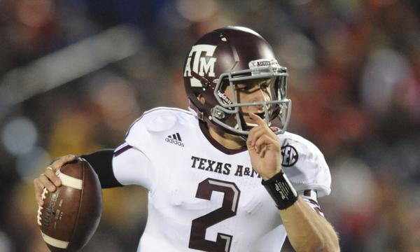 An autograph broker told ESPN that Texas A&M quarterback Johnny Manziel was paid for signing football helmets.