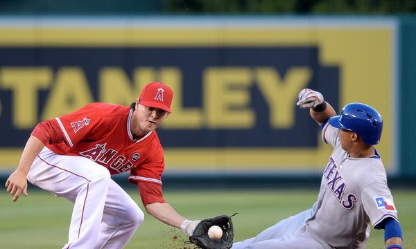 Texas Rangers outfielder Leonys Martin, left, gets under the tag of the Angels' Grant Green to steal second base during the Angels' 8-3 loss.