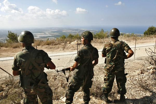 Lebanese soldiers guard guard their country's side of the border with Israel.