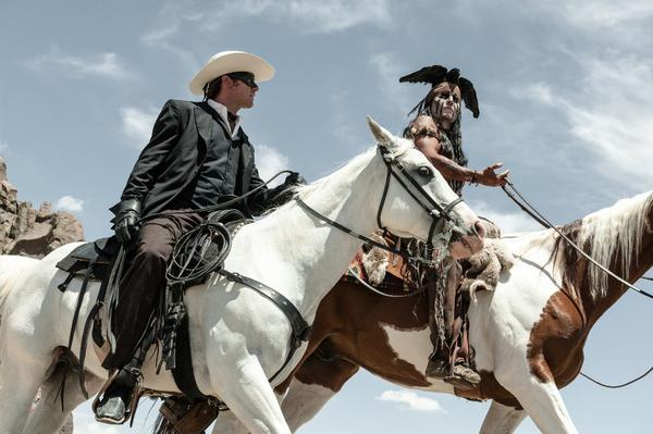 """The Lone Ranger"" starring Armie Hammer, left, and Johnny Depp lost a lot of money for Disney."