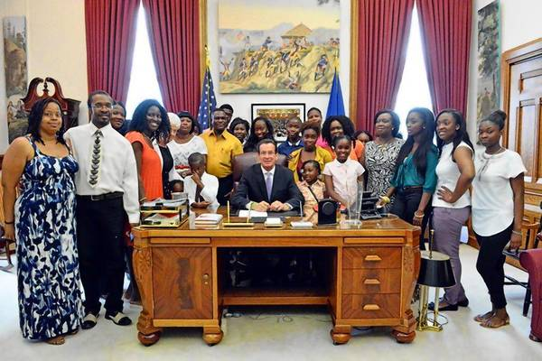 Members of Ghanian Youth Educational Outreach of USA gathered July 12 in Gov. Dannel P. Malloy's office. The group, which has many members from Manchester, pressed for a bill to improve safety at school pools, which the governor signed. Malvrick Donkor, a Manchester High School freshman and immigrant from Ghana, drowned in the school pool last year.