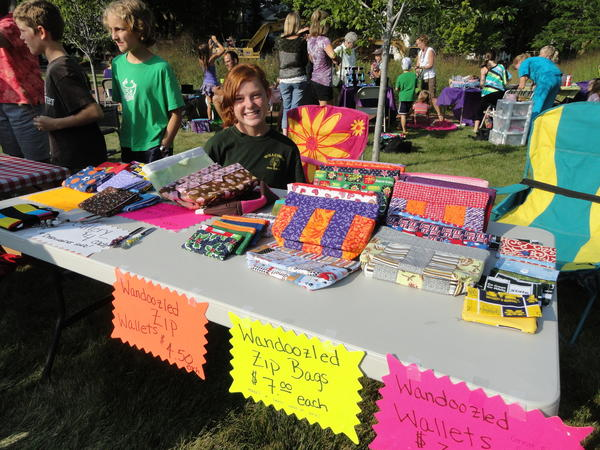 Anna Slack sells her reusable sandwich wrappers and lunch totes at last year's youth craft show in Charlevoix.