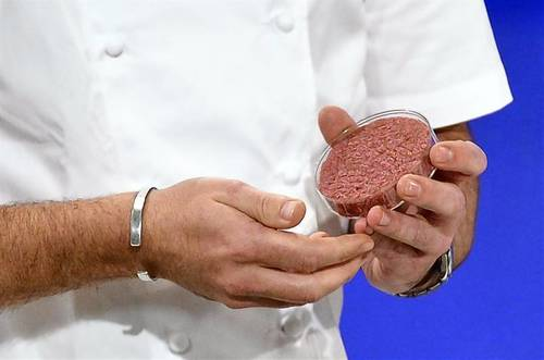World's first in-vitro beef burger cooked in London.