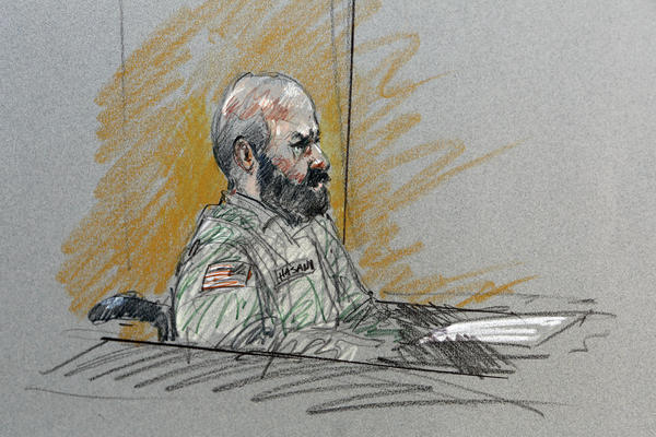 In this courtroom sketch, Maj. Nidal Malik Hasan sits in court for his court-martial Tuesday at Ft. Hood.