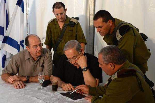 Israeli Prime Minister Benjamin Netanyahu, center, is briefed Wednesday at a base in southern Israel about military activity in the area.
