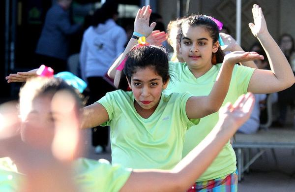 "Left to right: Tolou Pharokhipanah, 12, and Christina Baltayan, 13, of Toll Middle School dances with the Toll Elite Dance Group during the ""30th Annual National Night Out,"" at the Pacific Community Center in Glendale on Tuesday, August 6, 2013."