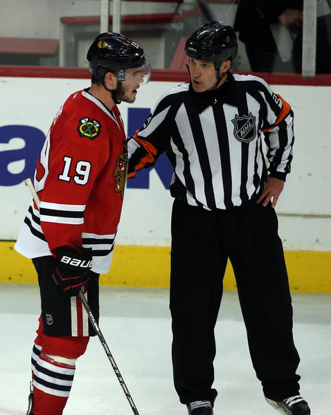Blackhawks captain Jonathan Toews talks to referee Stephen Walkom after Niklas Hjalmarsson's goal was disallowed in the third period against Detroit in Game 7 of NHL Western Conference semifinals.