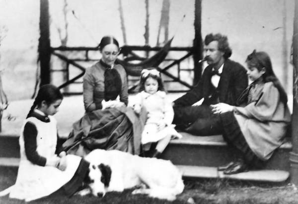 In 1891, Mark Twain took his family to live in Germany for 6 months. This portrait, taken in 1885 at the family's Hartford home, shows, left to right, Clara Clemens, Livy Clemens, Jean Clemens, Sam Clemens (Mark Twain) and Susy Clemens. The dog's name is Hash.