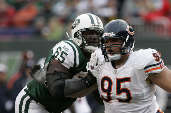 Chicago Bears defensive lineman Ian Scott is blocked by New York Jets guard Brandon Moore (65) in the fourth quarter of game played at Giants Stadium in East Rutherford, N.J. on Nov. 19, 2006.