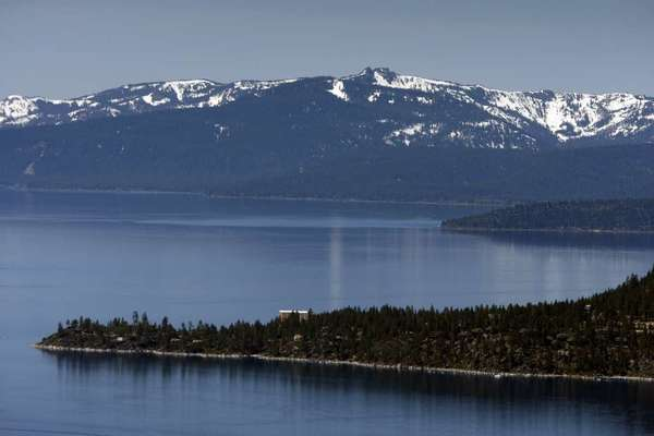 Lake Tahoe's famously clear blue waters retain their clarity, but a report warns that climate change may cause long-term harm to the lake.