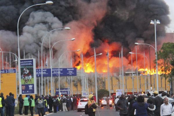 Smoke billows from a massive fire at Jomo Kenyatta International Airport in Nairobi, Kenya.