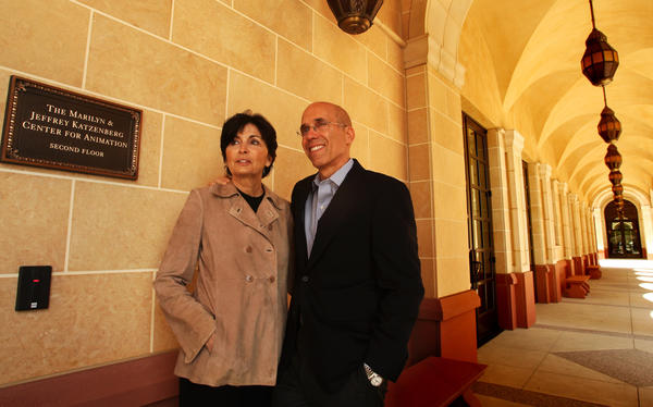 Jeffrey Katzenberg, chief executive of DreamWorks Animation, with wife Marilyn in 2011 next to a plaque that directs visitors to the Marilyn and Jeffrey Katzenberg Center for Animation inside the USC School of Cinematic Arts.