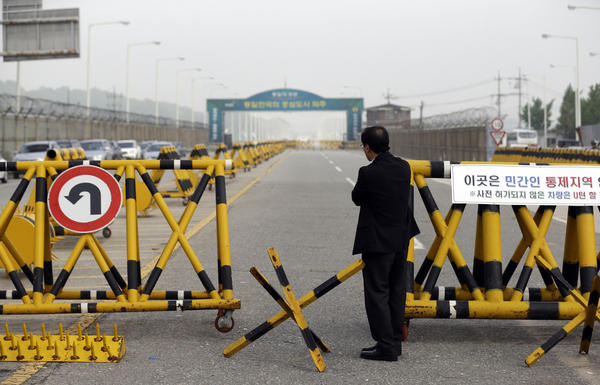A South Korean who runs a factory in the joint Kaesong industrial complex between North and South stands outside military barricades set up on Unification Bridge near the border village of Panmunjom.