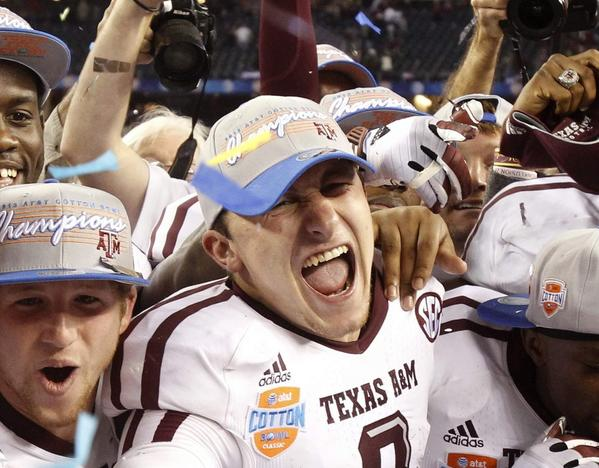 Texas A&M quarterback Johnny Manziel, center, celebrates with teammates following their victory over the University of Oklahoma in the Cotton Bowl on Jan. 4.