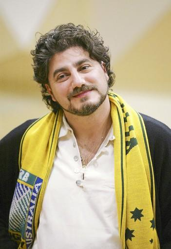 Tenor Jose Cura, pictured in 2003, wears a Wallabies supporters scarf while visiting Australia.