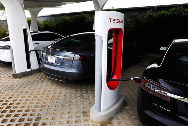 Tesla Motors' Model S roadsters are charged at the company's design studio in Hawthorne.