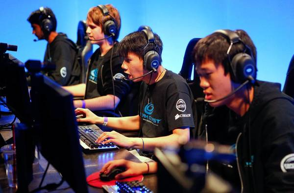 "Team Coast members, from left, Darshan ""ZionSpartan"" Upadhyaya, Josh ""NintendudeX"" Atkins, Danny ""Shiphtur"" Le and Brandon ""DontMashMe"" Phan. Le is the first eSports player to be granted a visa usually reserved for pro athletes."