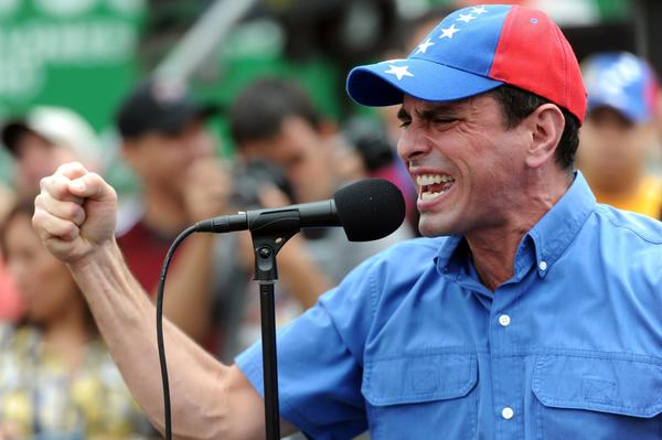 Venezuelan opposition leader Henrique Capriles delivers a speech during a protest against corruption in Caracas on Aug. 3, 2013.