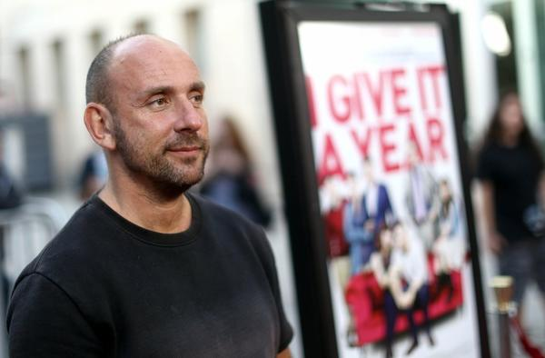 "Writer and director Dan Mazer arrives on the red carpet at a special screening for ""I Give It A Year"" in Los Angeles."